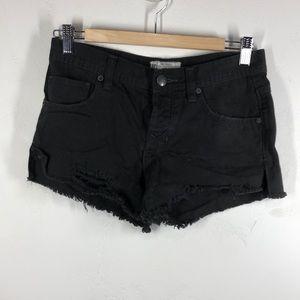 Free People black distressed jean shorts size 24